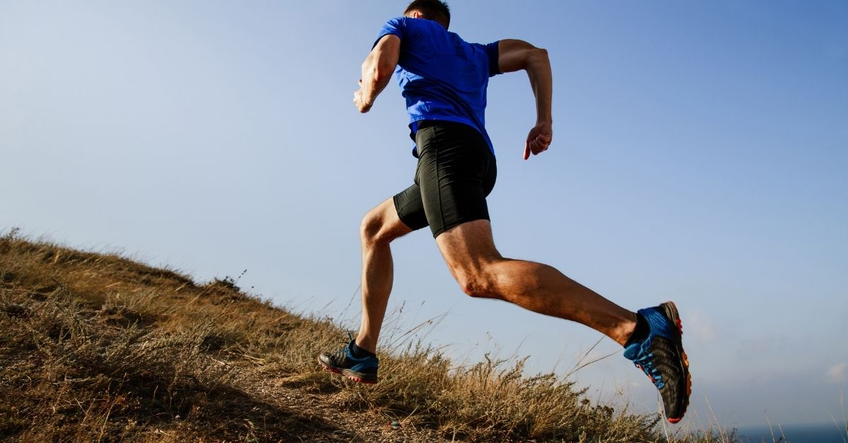 man running uphill with good form