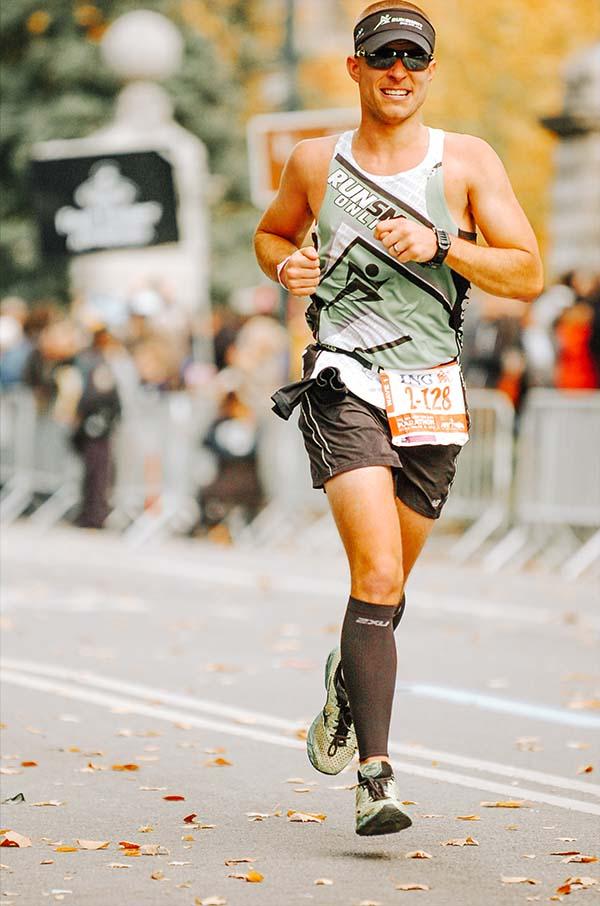 female runner running through park